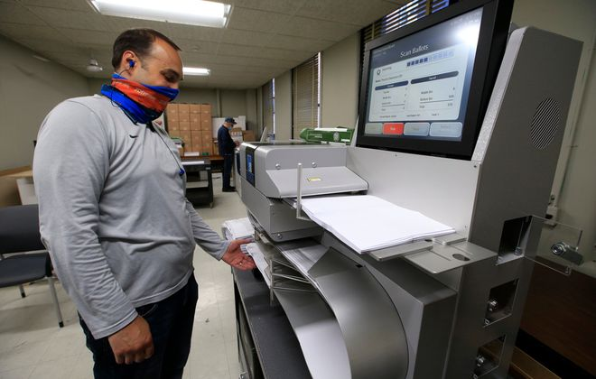 Mike Agostino from the Board of Elections scans Holland school votes at the Erie County Board of Elections on Tuesday, June 16, 2020. (Harry Scull Jr./Buffalo News)