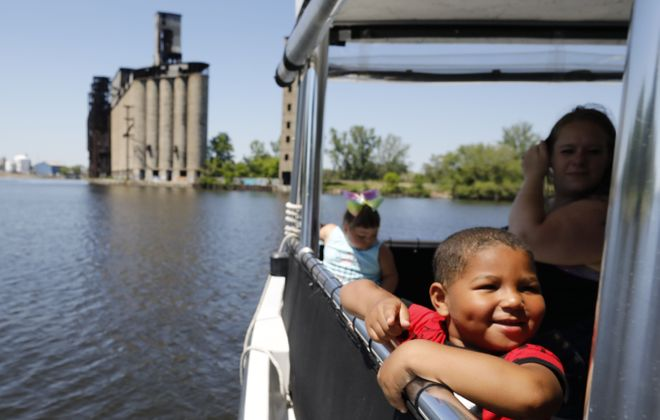 Will Rogers, 3, happily  takes in the view during a Buffalo River History Tour aboard the Harbor Queen. (Derek Gee/Buffalo News)