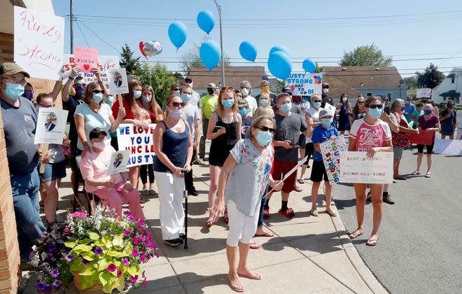 Dolores Browning of Blasdell, center in grey, waits for her husband's release Catholic Health Covid-19 Treatment Facility at St. Joseph Campus in Cheektowaga. (Robert Kirkham/Buffalo News)