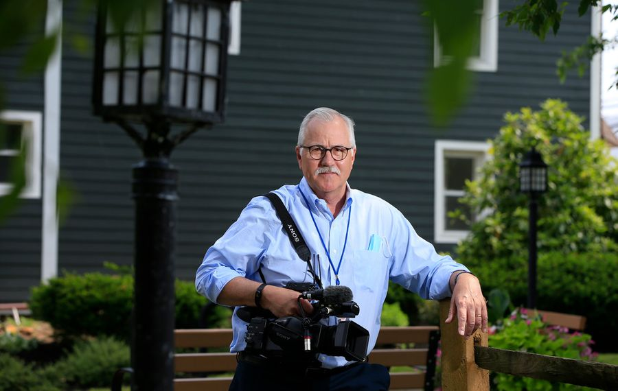 WKBW's Mike Randall at work on Tuesday in Eden. (Harry Scull Jr./Buffalo News)