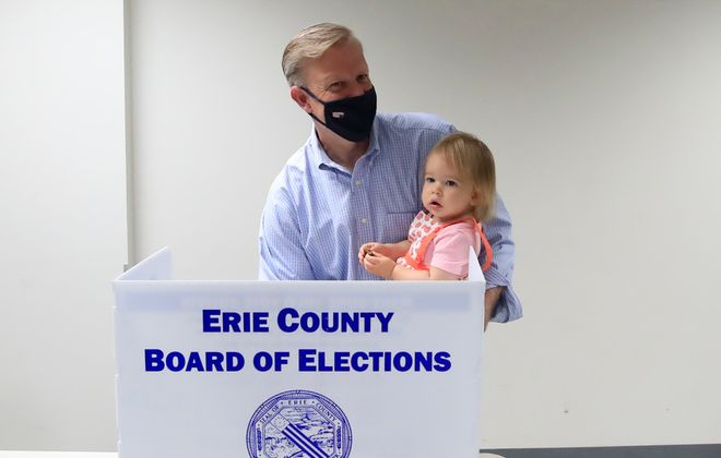 Chris Jacobs and his daughter, Anna, vote at the Orchard Park Municipal Center on Tuesday, June 23, 2020. (Harry Scull Jr./Buffalo News)