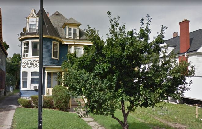 Ellicott Development is asking to demolish the home on the left, at 878 Elmwood, and combine it with the adjacent lot for a new apartment building. (Google)