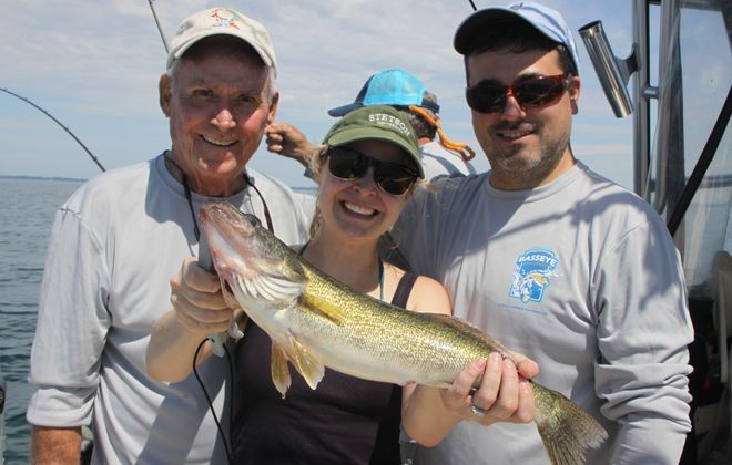Capt. Gary Ellis with his daughter Nicole and her husband Joe Gavigan show off one of many walleyes caught during last year's BassEye contest to benefit CF. Last year's event was the final one. (Photo courtesy of Bill Hilts, Jr.)