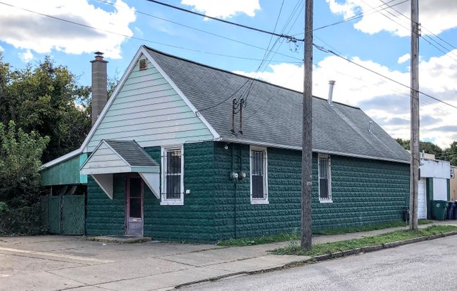 This small, green, nondescript building in Niagara Falls has been broken into twice in the past eight months, but the owner has recovered each time thanks to the outpouring of support from the neighborhood. (Ben Tsujimoto/News file photo)