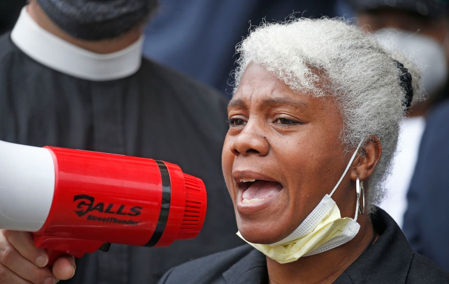 At a recent City Hall rally against police abuse organized by clergy, former officer Cariol Horne describes her life after being fired for trying to stop a colleague she feared was choking a suspect.  (Robert Kirkham/Buffalo News)