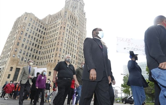 The 'Community of the Faithful' rally in Niagara Square