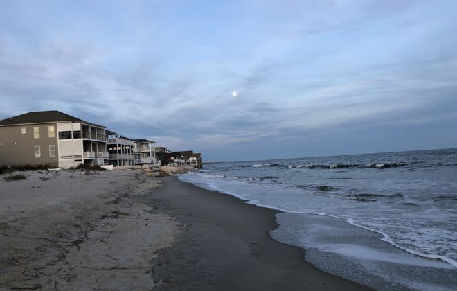This photo of oceanfront homes on a beach on the Outer Banks of North Carolina  doesn't illustrate sea level rise to a casual visitor, but residents of Ocean Isle Beach know there used to be two blocks of homes in front of the current row of homes. (NASA)