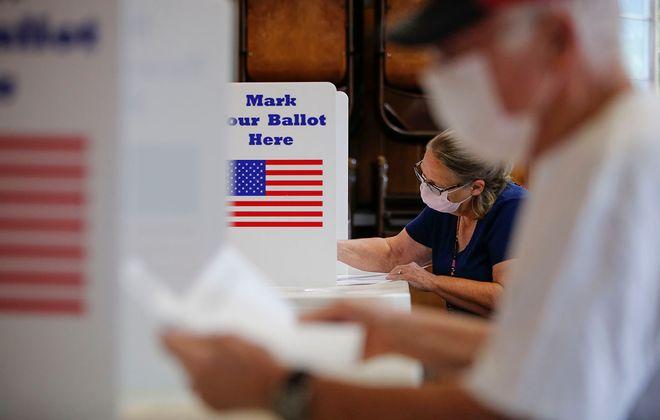 Robert and Elaine Kyser fill out their ballots in the Hamburg Community Center on June 23. (Derek Gee/Buffalo News)