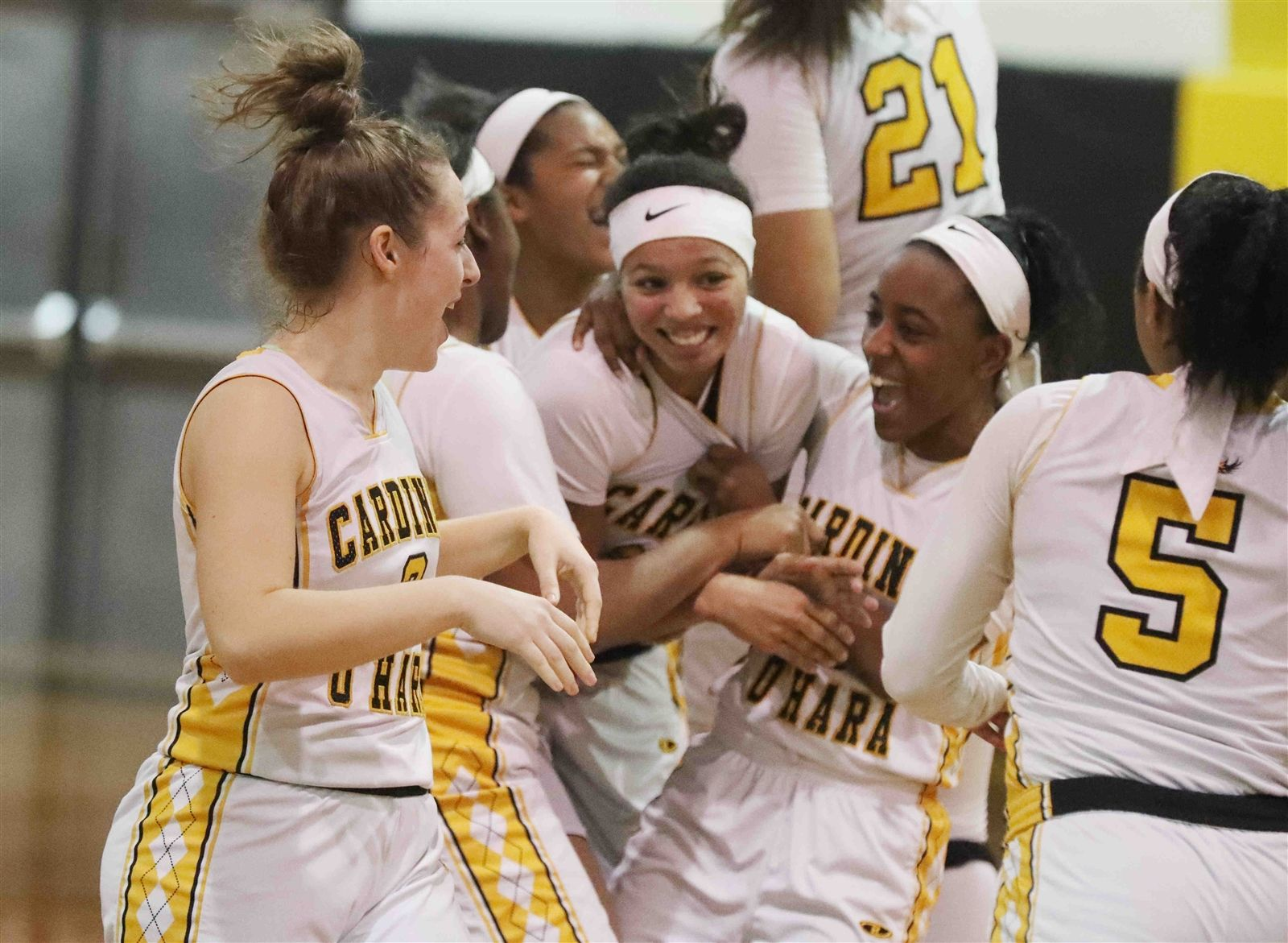 Cardinal O'Hara's Cierra Harrison is mobbed by her teammates after she scored a three-point basket with no time left to send the game into overtime against Jamesville-DeWitt.