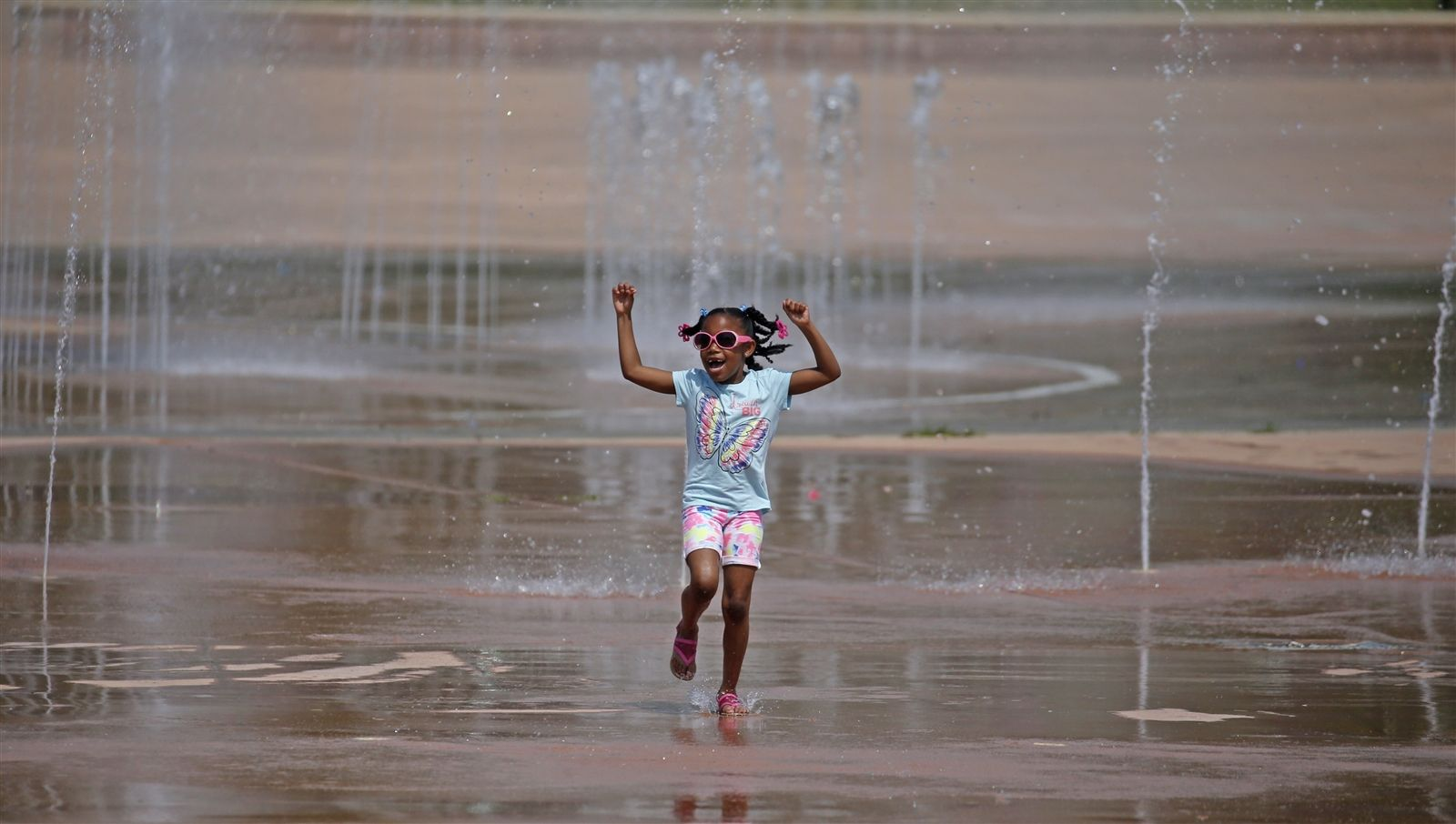 This little girl loves the park's water features.