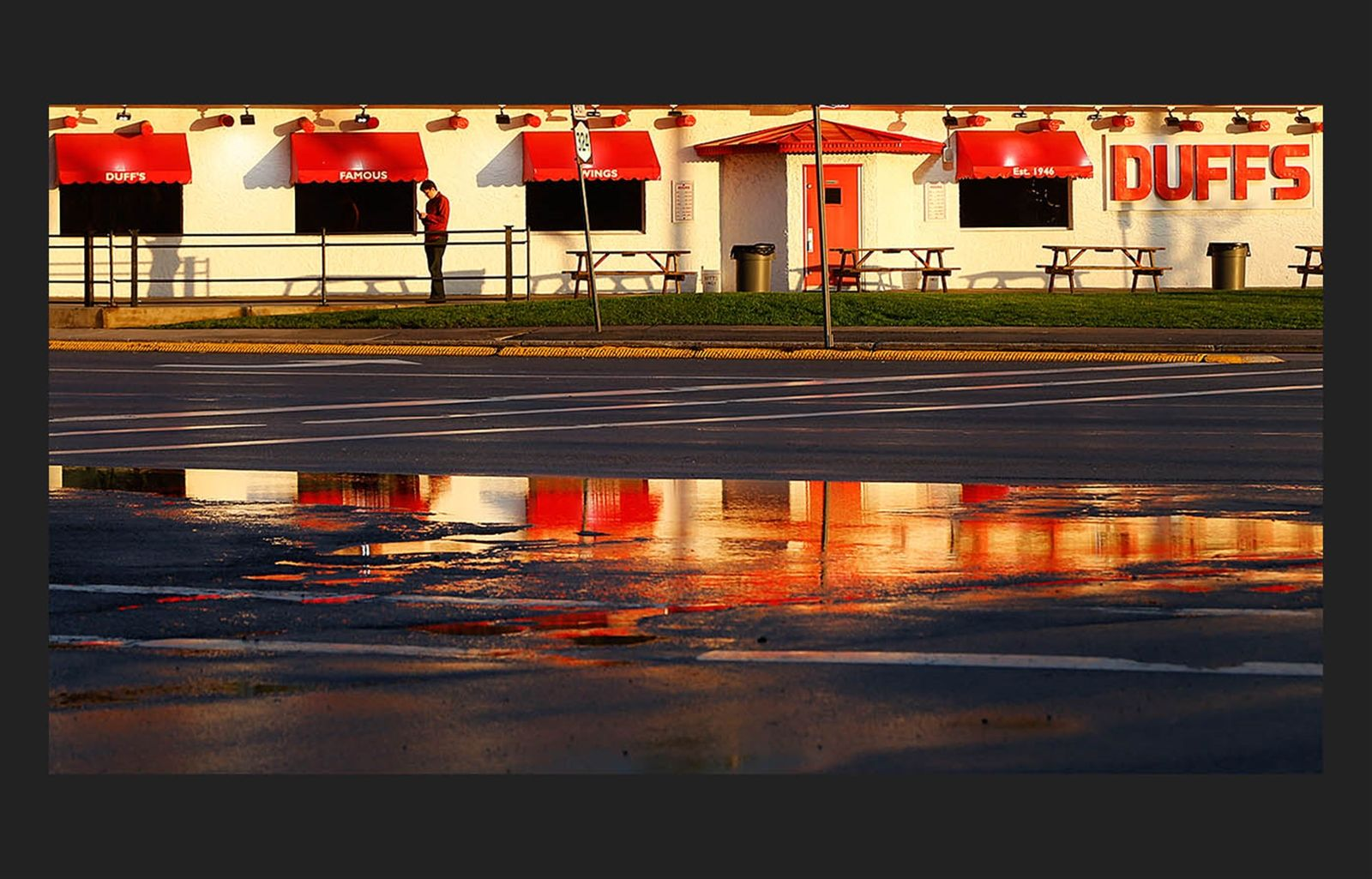 Day 121: May 1, 2017 - Calm after the storm: Duff's on Sheridan in Amherst reflects in a puddle left over from the storm.