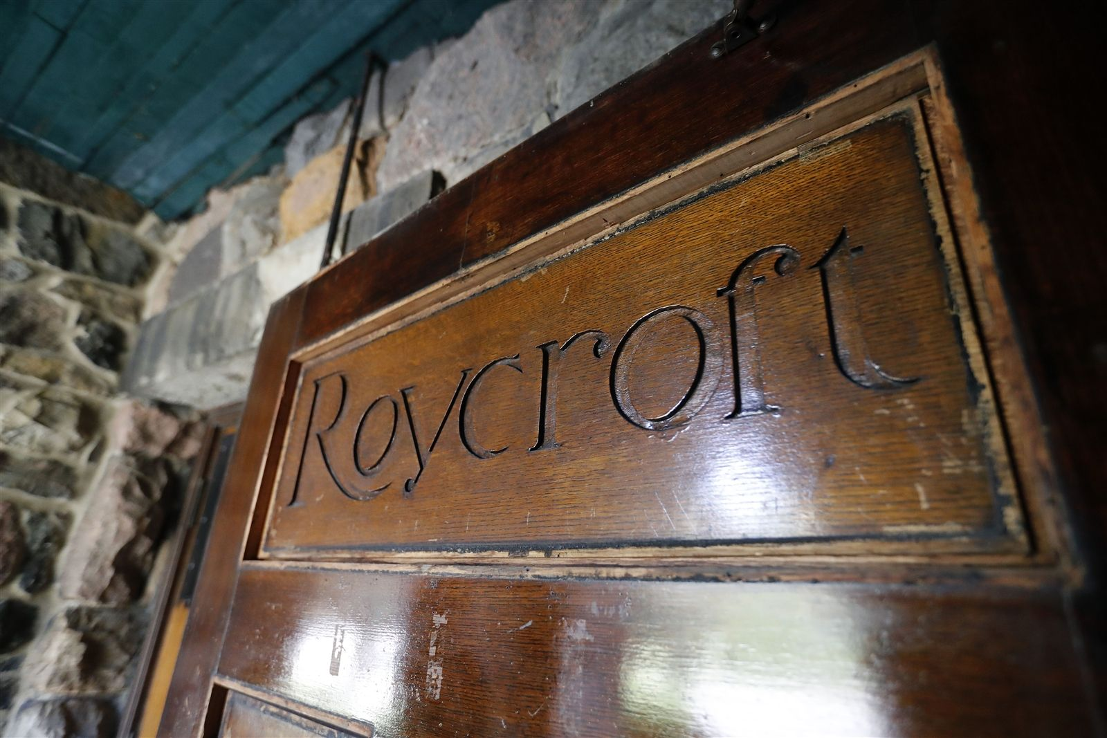 """The Roycroft name and symbol came from the combination of two words:  """"royal"""" and """"craft,"""" symbolizing an object so well-made it was fit for royalty. The Roycroft logo design has a circle with a two-armed cross above it.  Believed to be from medieval times, it was used by monks at the end of their illuminated manuscripts. Founder Elbert Hubbard put the R inside the circle to make it represent the Roycroft."""