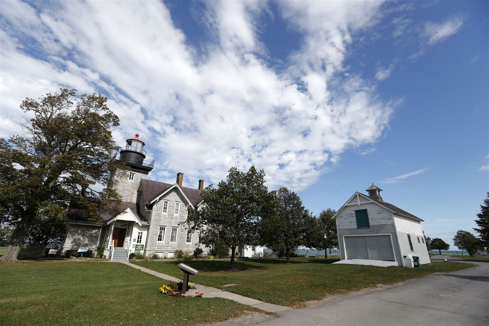 Thirty Mile Point Lighthouse was built in 1875 at the cost of $90,000. Through the centuries, there have been at least four shipwrecks on the treacherous shoals and shifting sandbar off Thirty Mile Point, so named because it is 30 miles east of the Niagara River