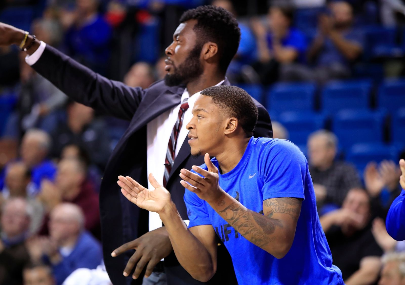 University at Buffalo guard Wes Clark cheers on his team from the bench against Jacksonville State during second half action.