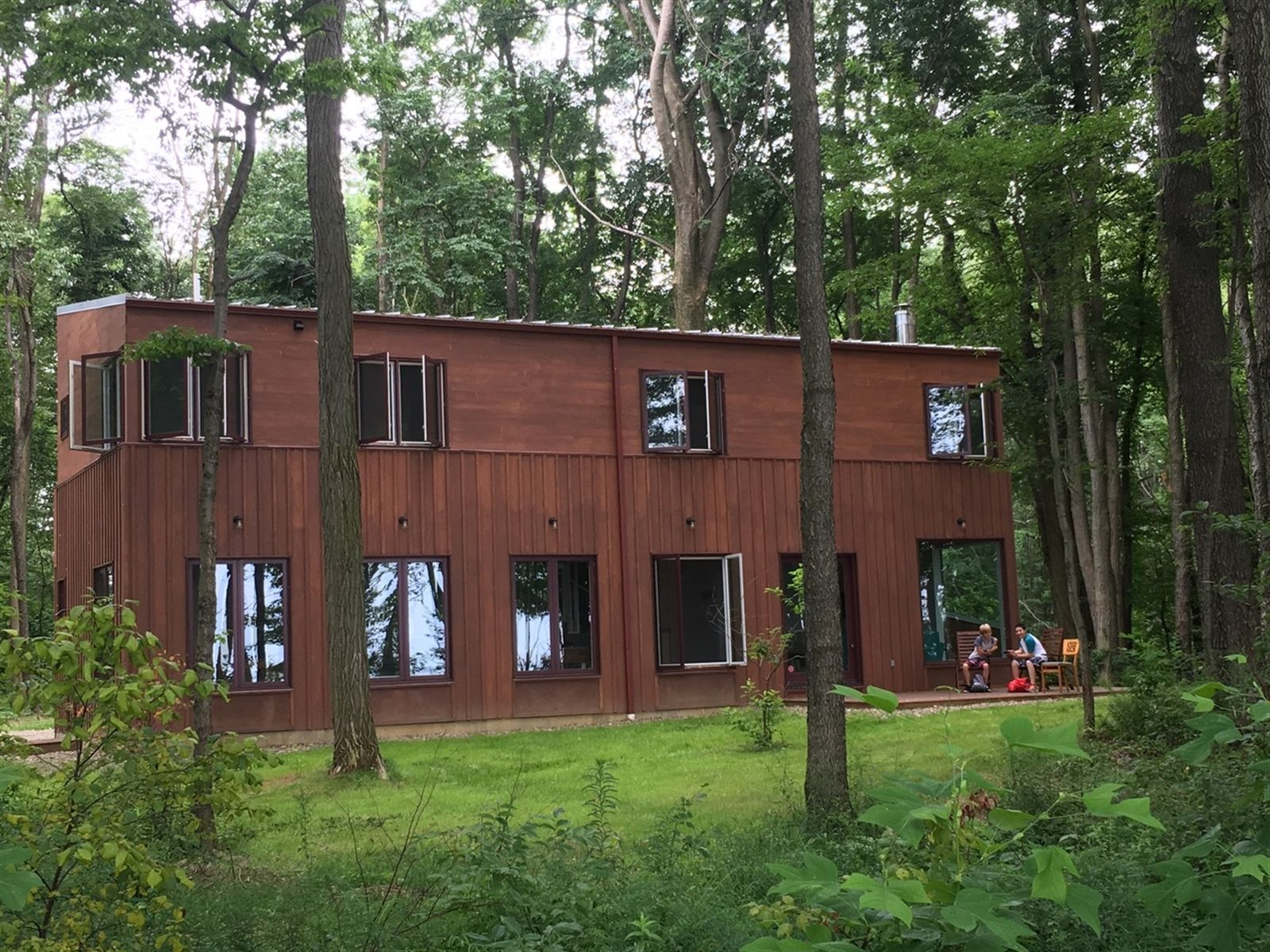 The exterior siding is board and batten cedar around the first floor and two types shiplap cedar around the second.