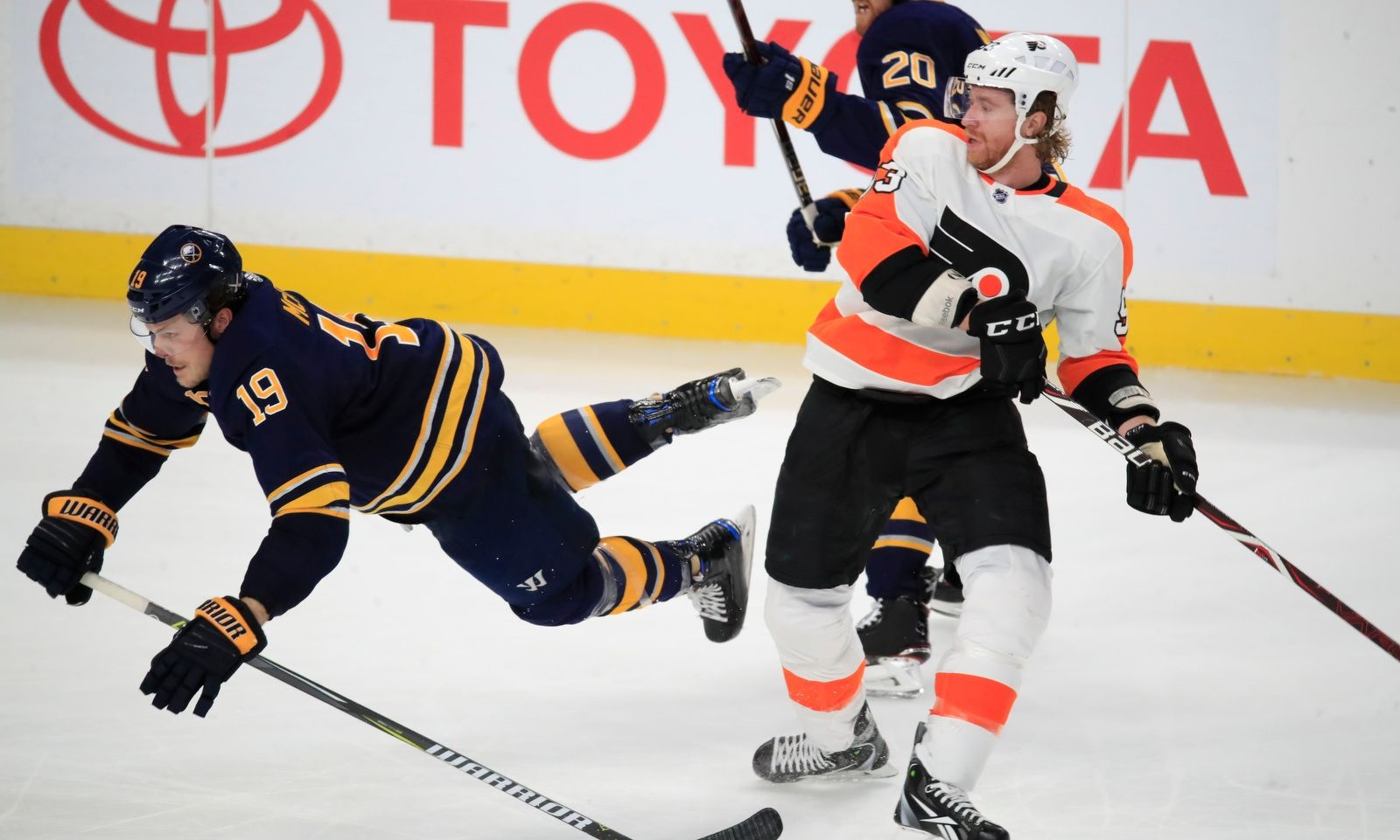 Buffalo Sabres defenseman Jake McCabe is checked by Philadelphia Flyers' Jakub Voracek during third period action at the KeyBank Center on Friday, Dec. 22, 2017.