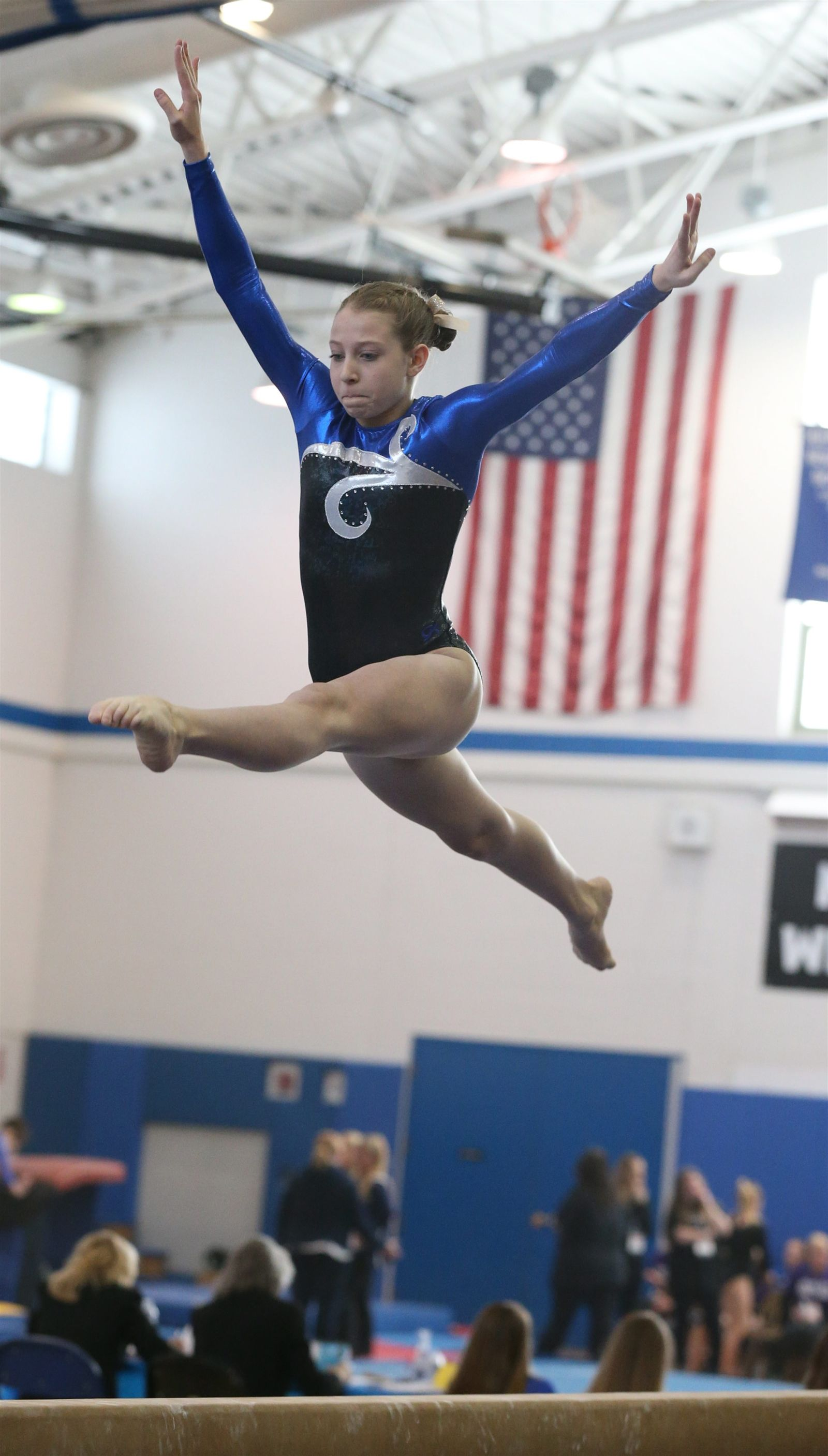 Makenzie Castiglione competes on the balance beam during the Section VI girls state gymnastics championships at Kenmore West High School in Kenmore,N.Y. on Saturday, Feb. 28, 2015.