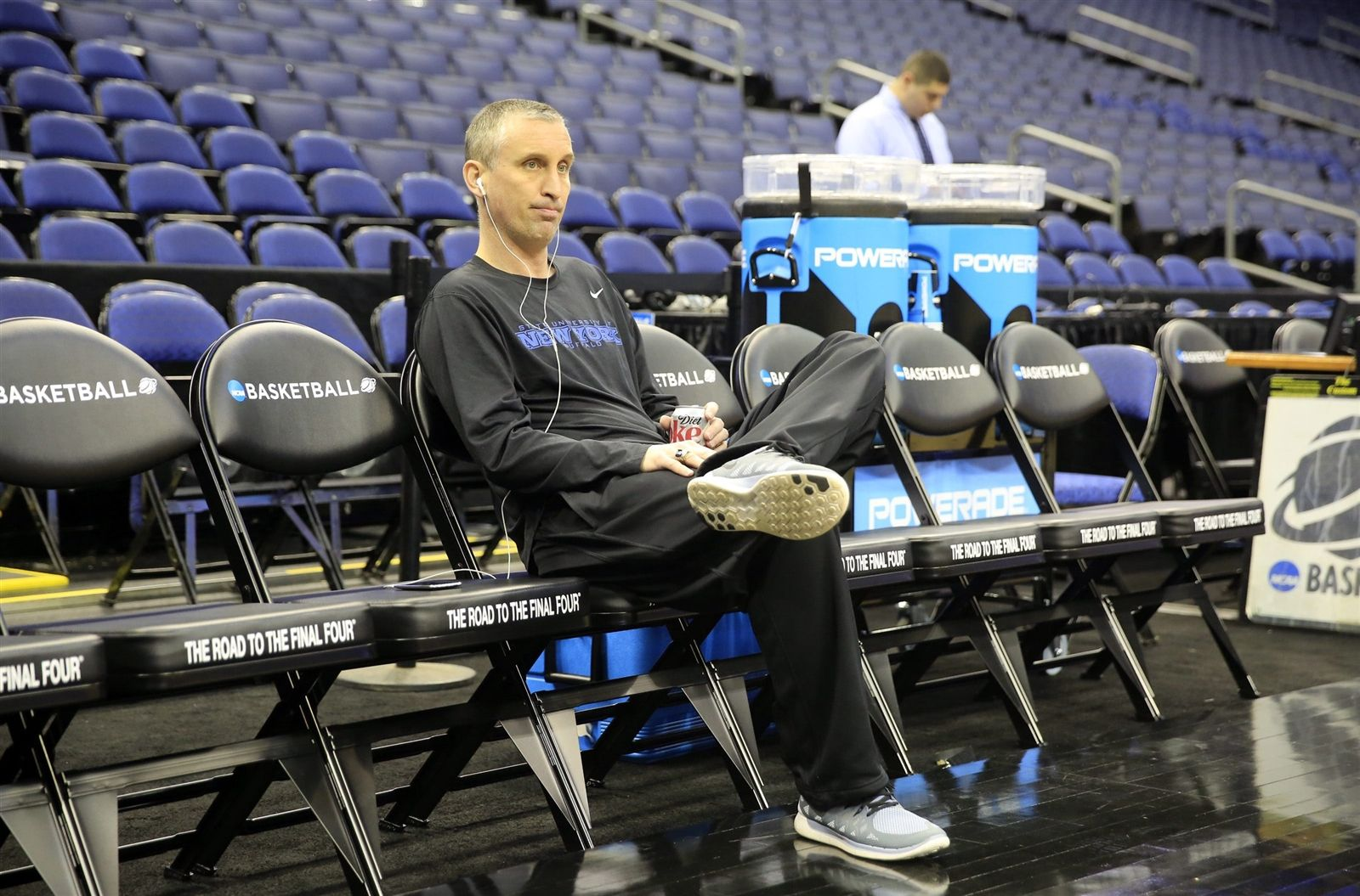 UB coach Bobby Hurley sits on the bench.
