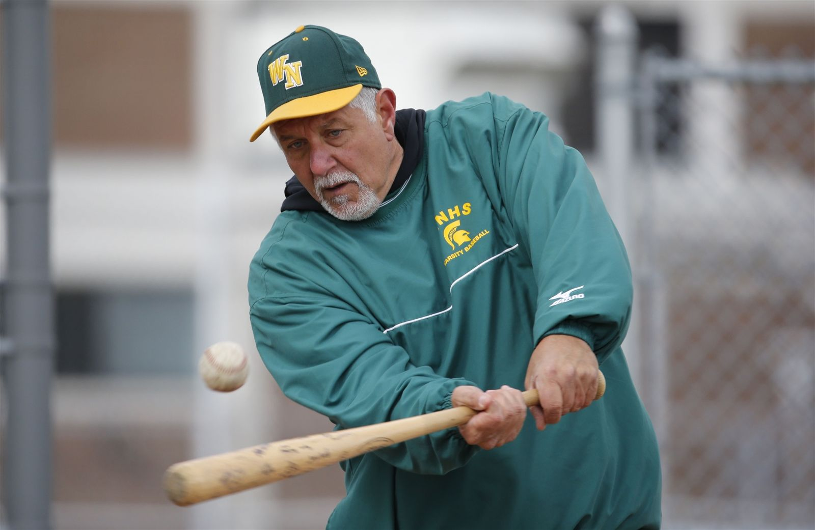 Williamsville North coach Jerry Scarcella hits infield.