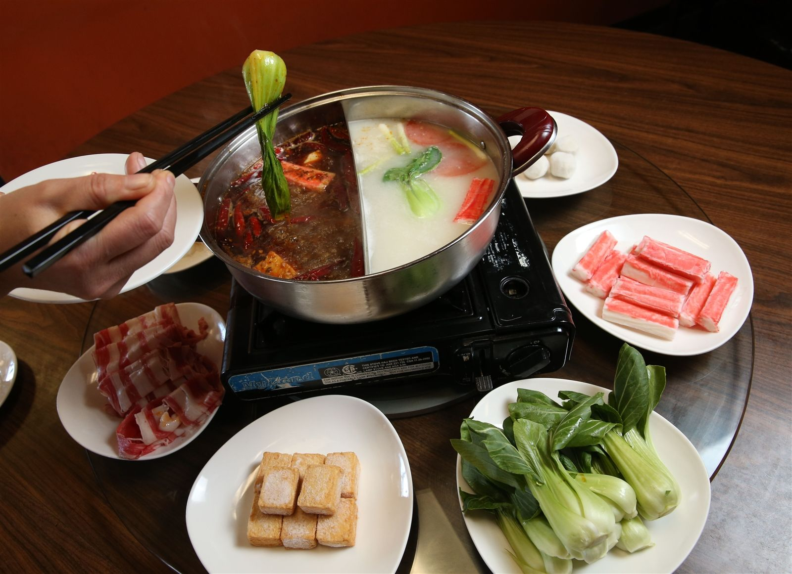 Among its collection of unique-for-WNY dishes, China Star serves Chong Qing hot pot. It's served family style, allowing diners to cook their choice of proteins and vegetables in two simmering broths, one spicy with chiles, the other mild chicken soup with scallion and tomato.