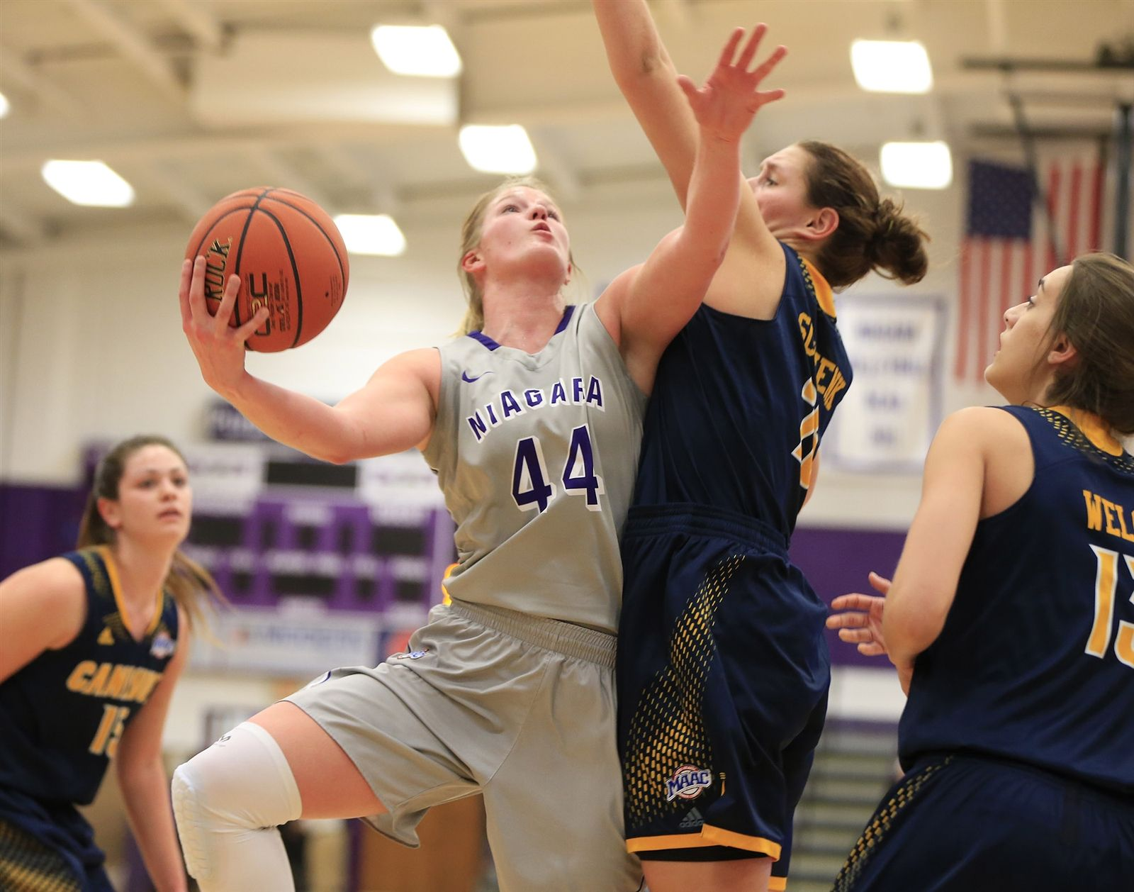 Niagara's Kaylee Stroemple drives to the basket against Canisius during first-half action at the Gallagher Center on Thursday, Jan. 28, 2016.