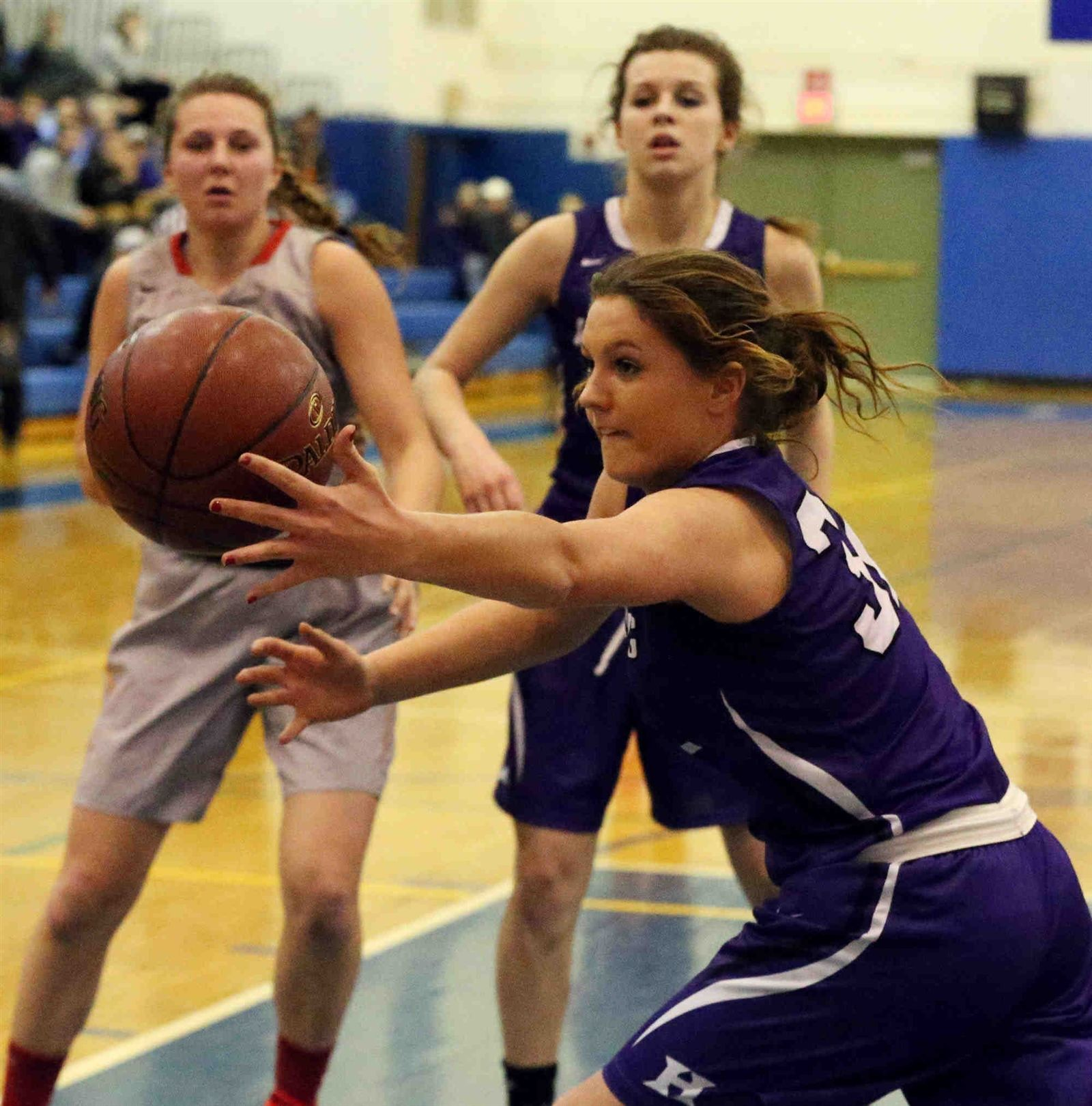 Williamsville East's Carly Shifflet battles Hamburg's Heather Habeman for the ball in the first half at Kenmore West high school in Kenmore on Wednesday, Feb. 24, 2016.