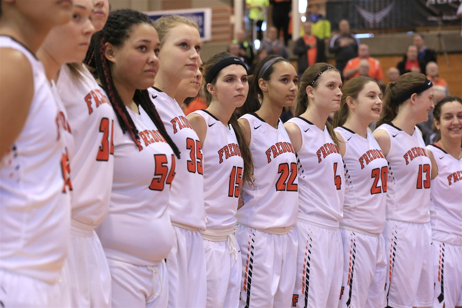 Fredonia players stand for the National Anthem prior to playing Southwestern in the B2 final at the Buffalo State Sports Arena  on Sunday, Feb. 28, 2016.