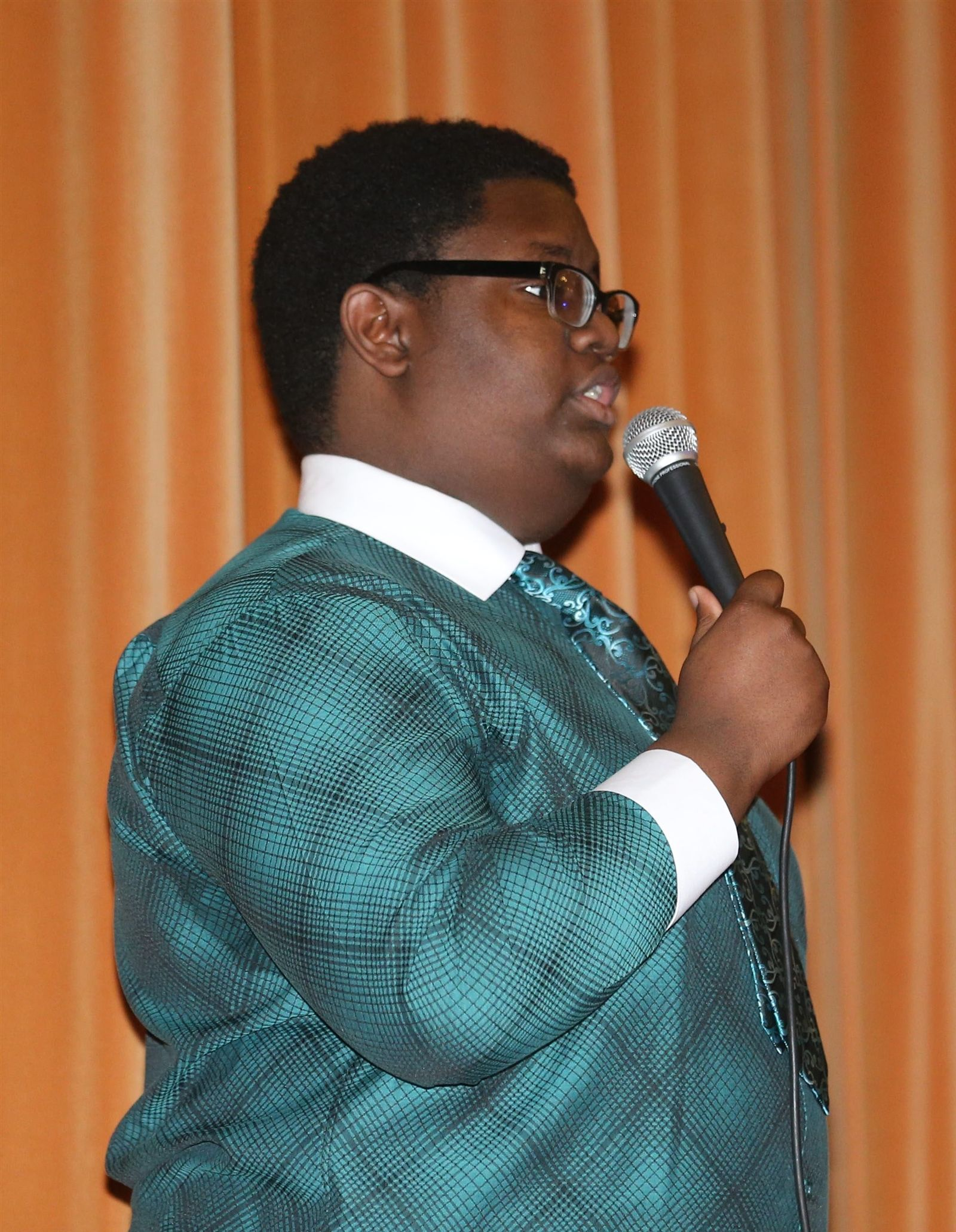 "Pathways Academy and East High School held an assembly for black history month with the theme ""Reaffirming Self-Identity and Cultural Acuity,"" on Monday. East High sophomore Alan Wilson Jr., sings ""A Change Is Gonna Come"" by Sam Cooke."