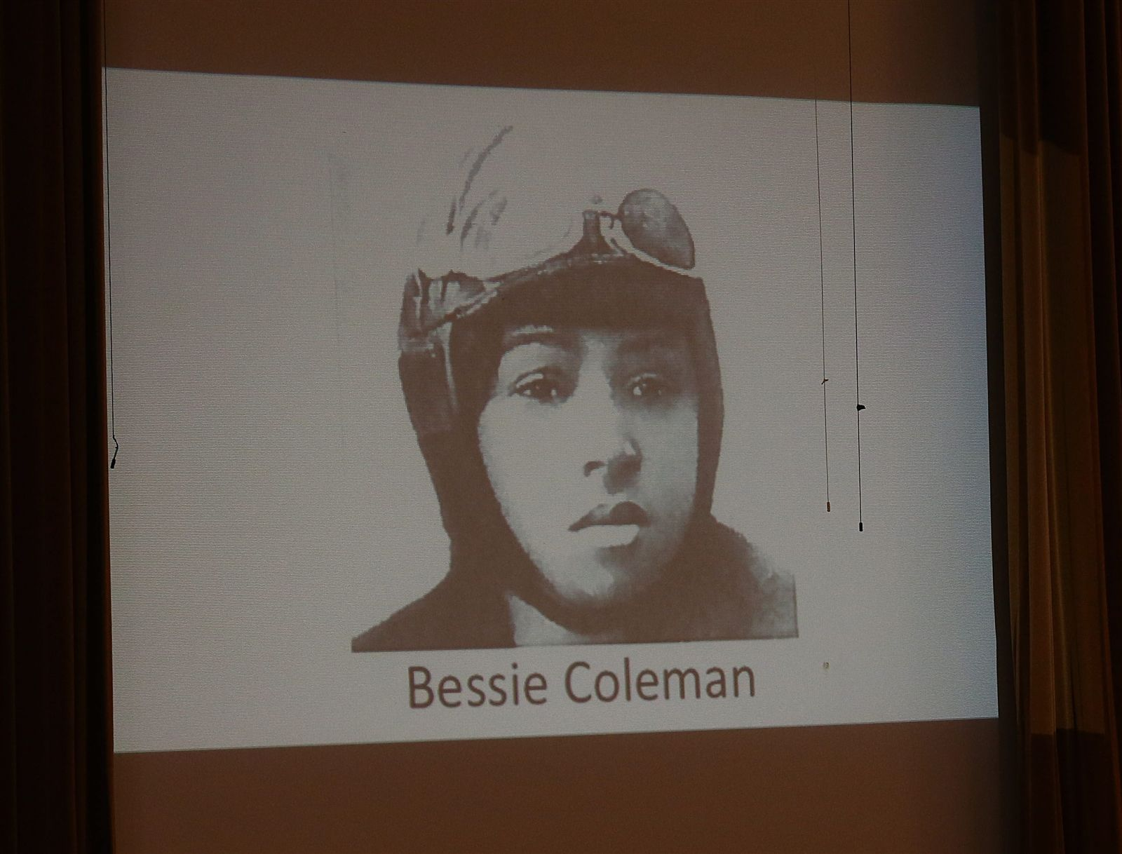 This is a photo of Bessie Coleman, the first female pilot of African American descent who got her license in 1921.