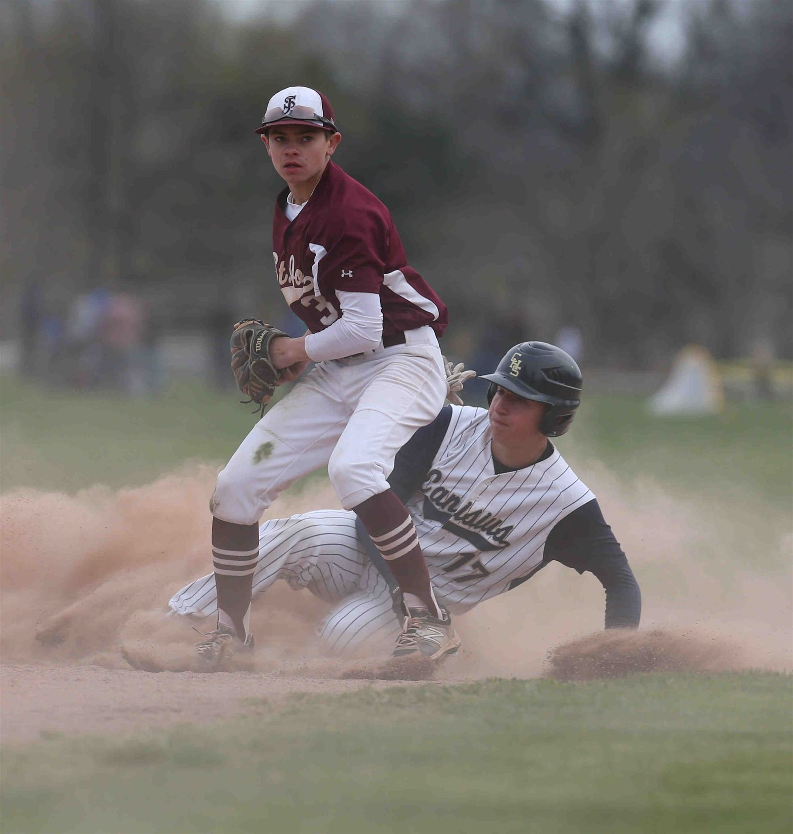 Canisius' Mike Mazzara is tagged out by St. Joe's  second baseman Luke Pierce in the fifth inning at Delaware Park in Buffalo on April 25.