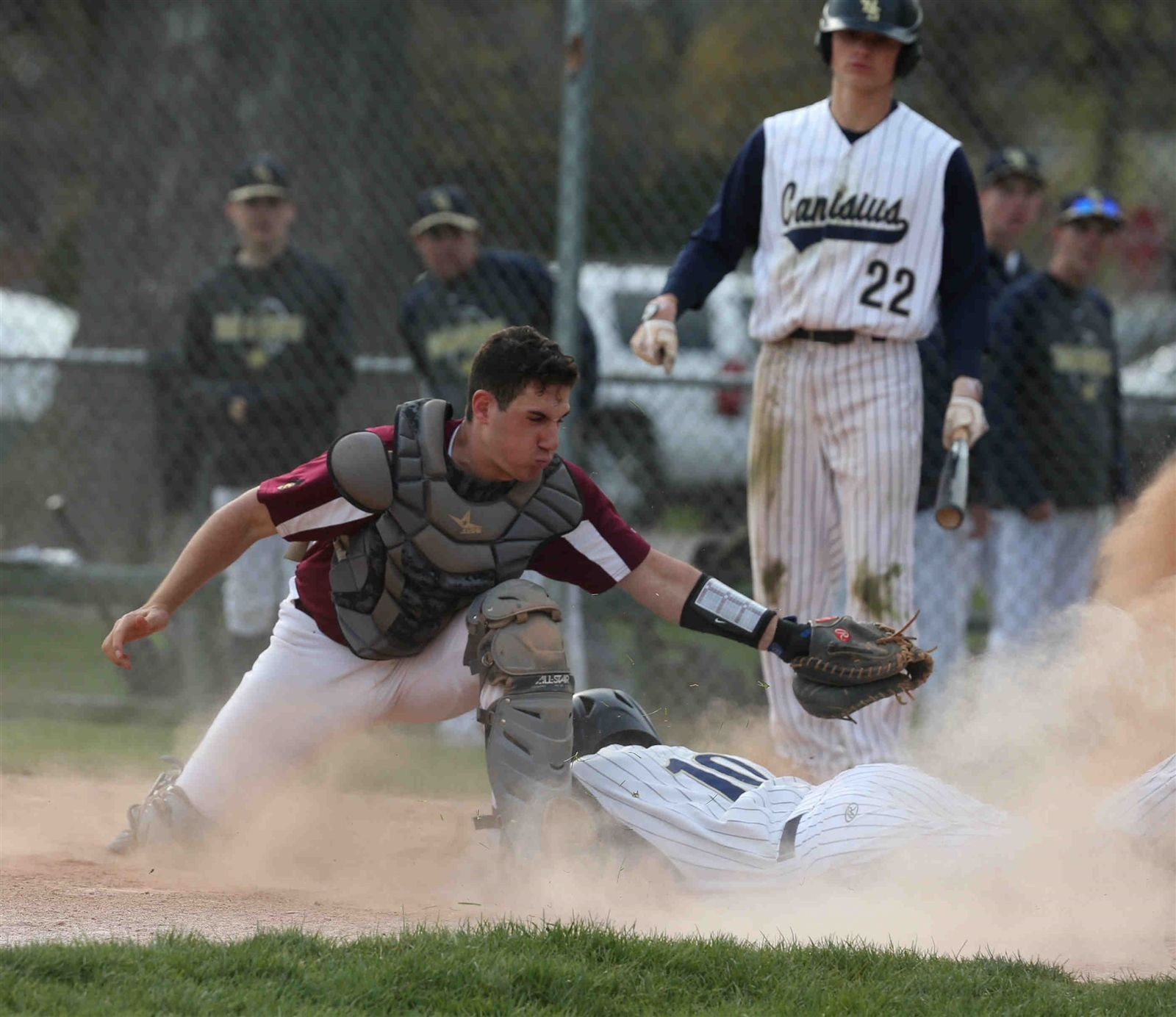 Canisius' Russ Mistretta is tagged out by St. Joe's catcher Dennis Gagiardo.