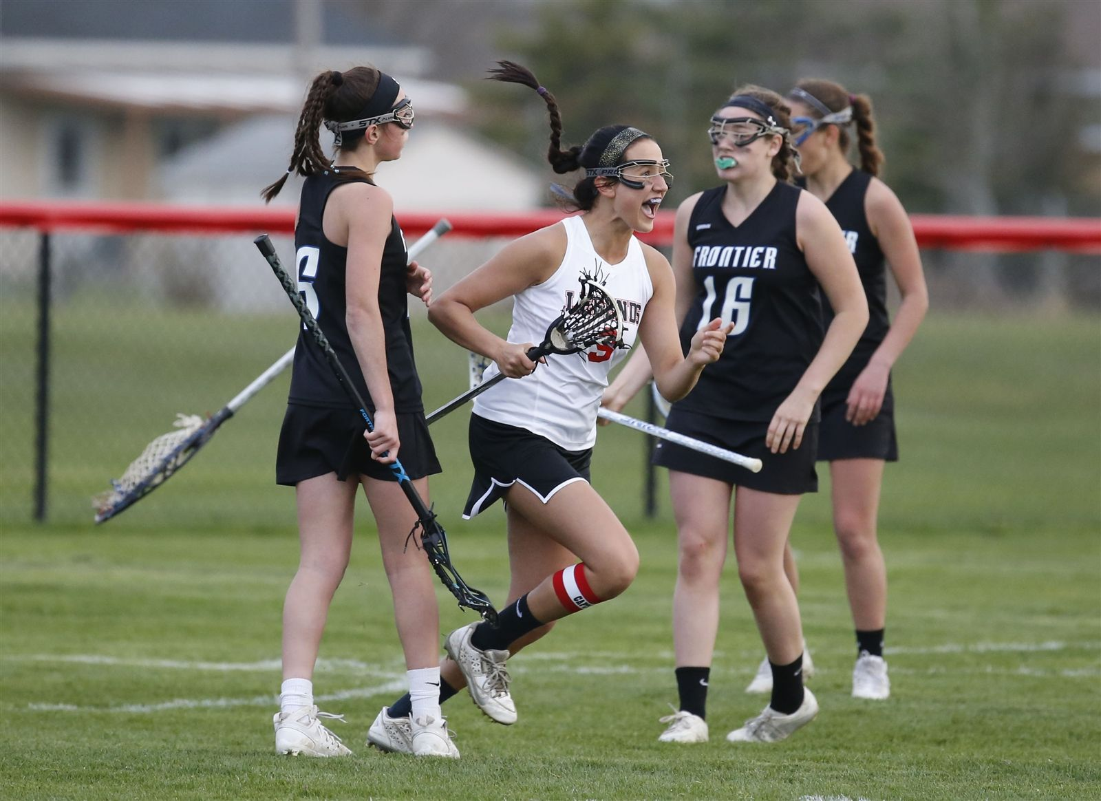 Lancaster's Jenna Hagen celebrates after scoring in overtime to defeat Frontier 11-10 at Lancaster high school on Friday, April 22, 2016.