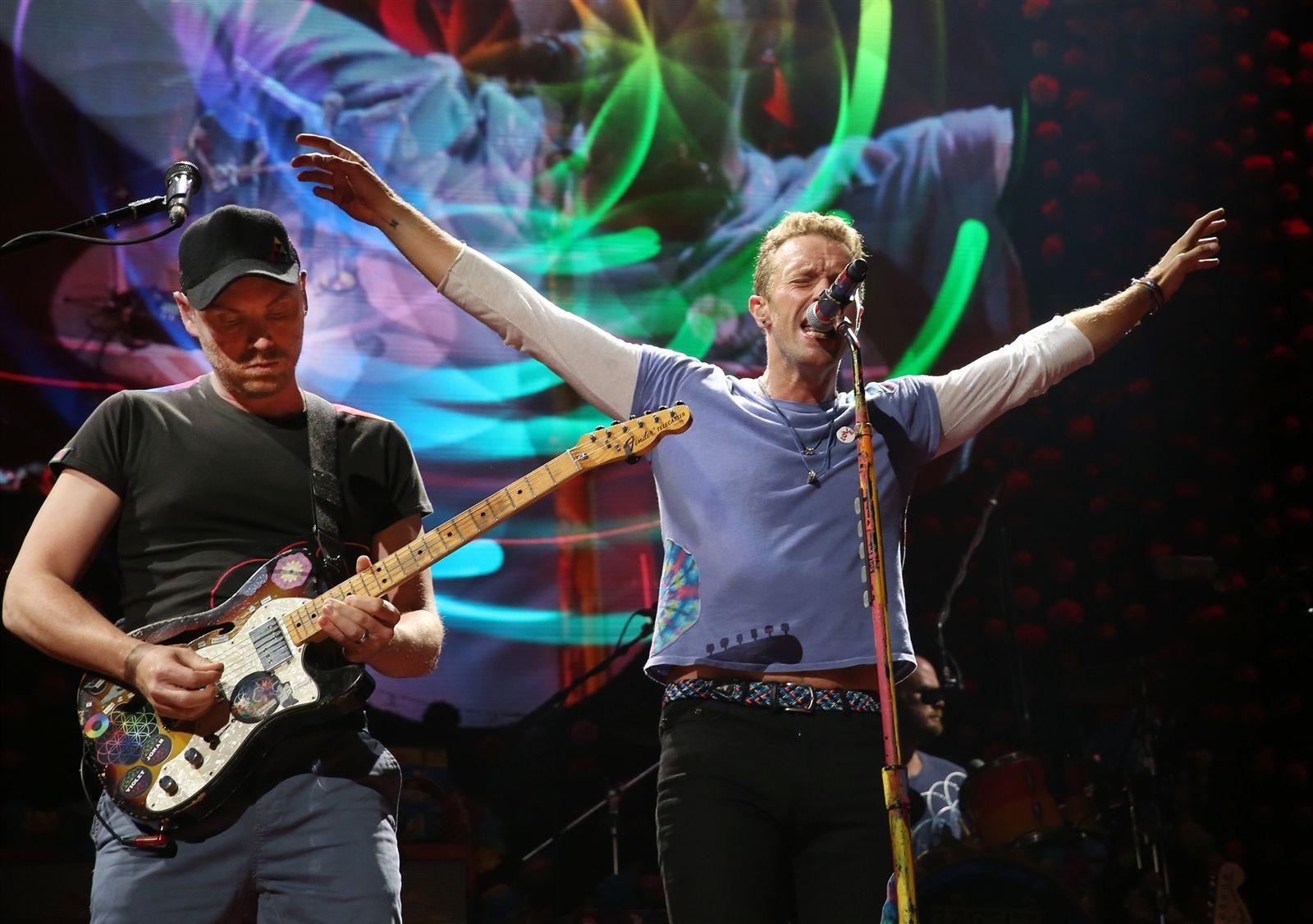 Band co-founders Jonny Buckland and Chris Martin.