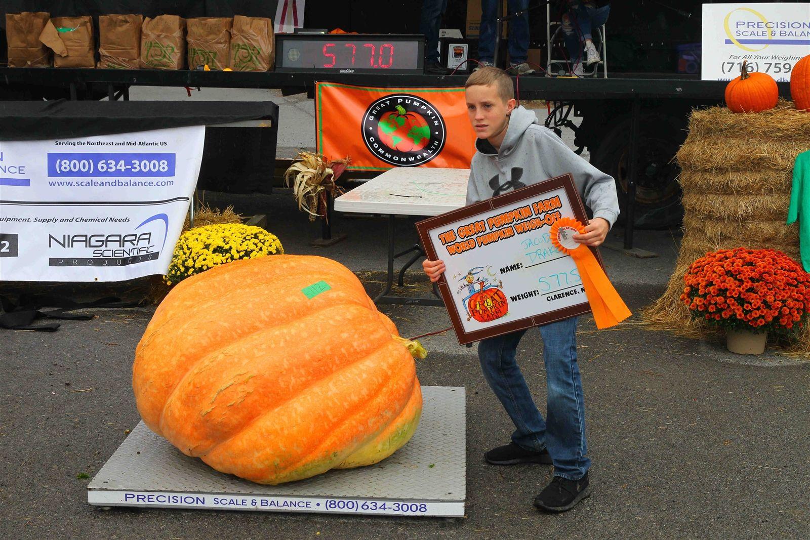 Jacob Drake, 13, of Niagara Falls, and his 577.5-pound pumpkin.