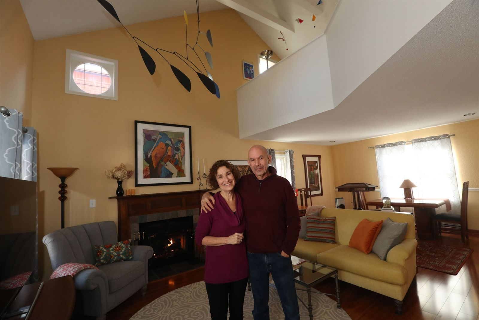 Nancy and Steve Siegel in the living room of their home in Buffalo.