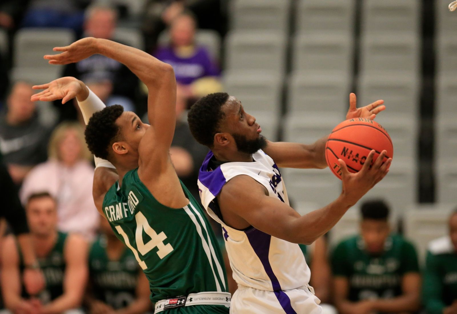 Niagarau2019s Marvin Prochet drives past Manhattan defender Calvin Crawford during first half action at the Gallagher center on Wednesday, Jan. 24, 2018.