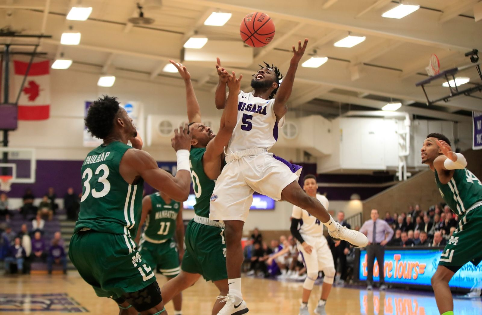 Niagara guard James Towns loses the ball against Manhattan during first half action at the Gallagher center on Wednesday, Jan. 24, 2018.