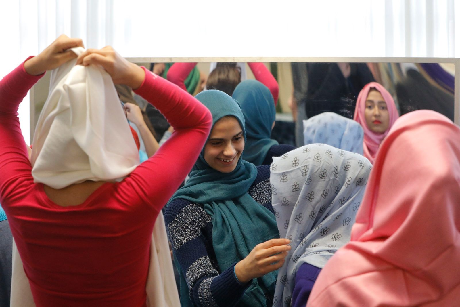 Students help each other put on and adjust their hijabs during an event to celebrate World Hijab Day at Leonardo daVinci High School.  On Feb. 1 of every year, World Hijab Day Organization asks global citizens of all faiths to wear the Hijab for a day in solidarity with Muslim women worldwide. u201cThe overall mission of WHD is to create a more peaceful world where global citizens respect each other.u201d