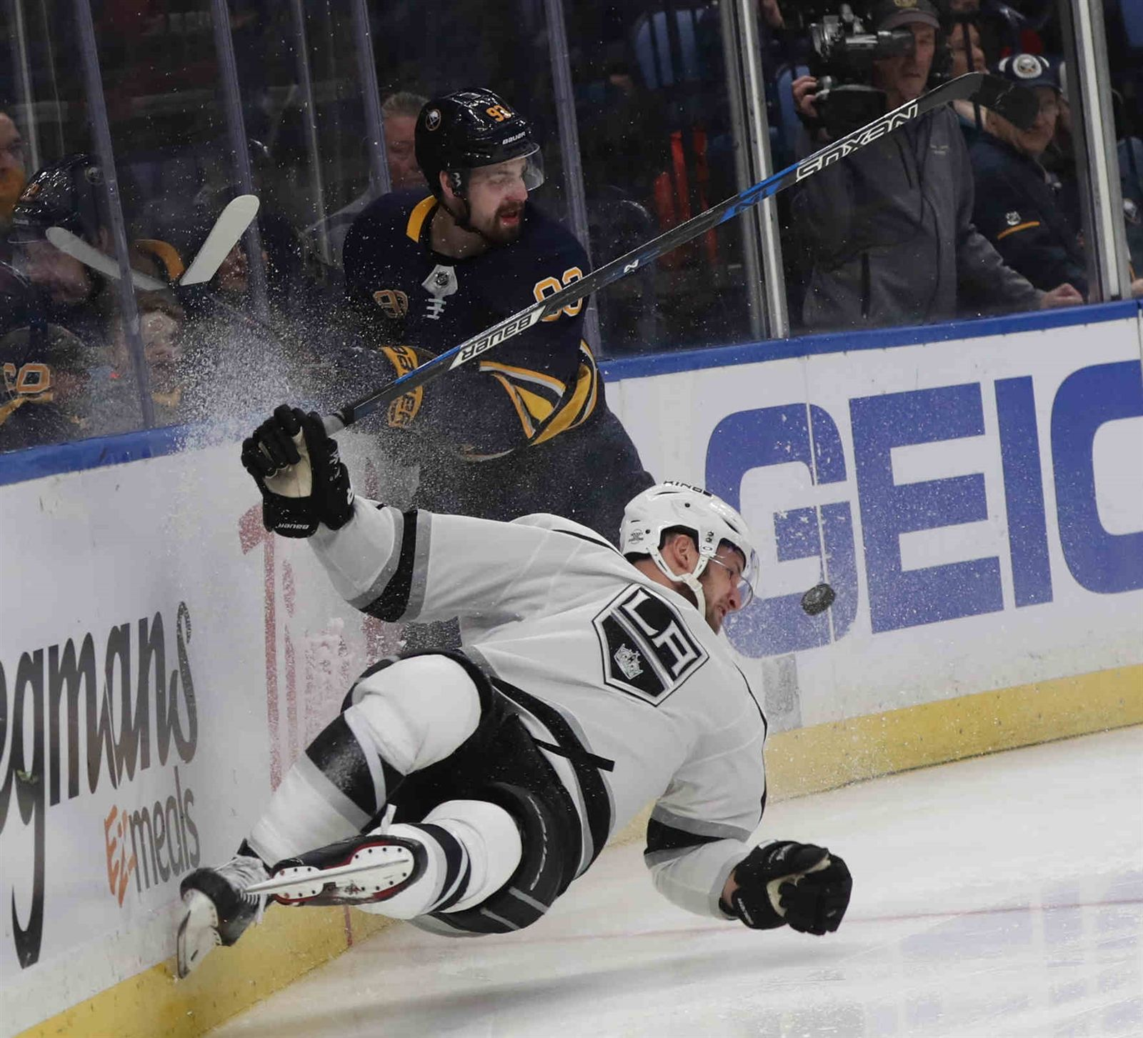 Buffalo Sabres defenseman Victor Antipin (93) hammers Los Angeles Kings left wing Kyle Clifford (13) in the second period.