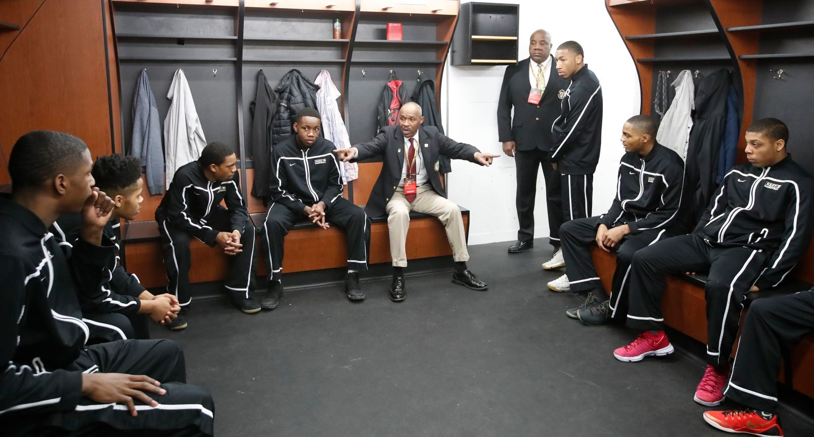 East coach Starling Bryant talks to his team in the locker room prior to playing Harrisville in the Class D semifinal of the the 2018 New York State Public High School Athletic Association boys basketball championship at the Floyd L. Maines Veteran Memorial Arena in Binghamton on Friday, March 16, 2018.