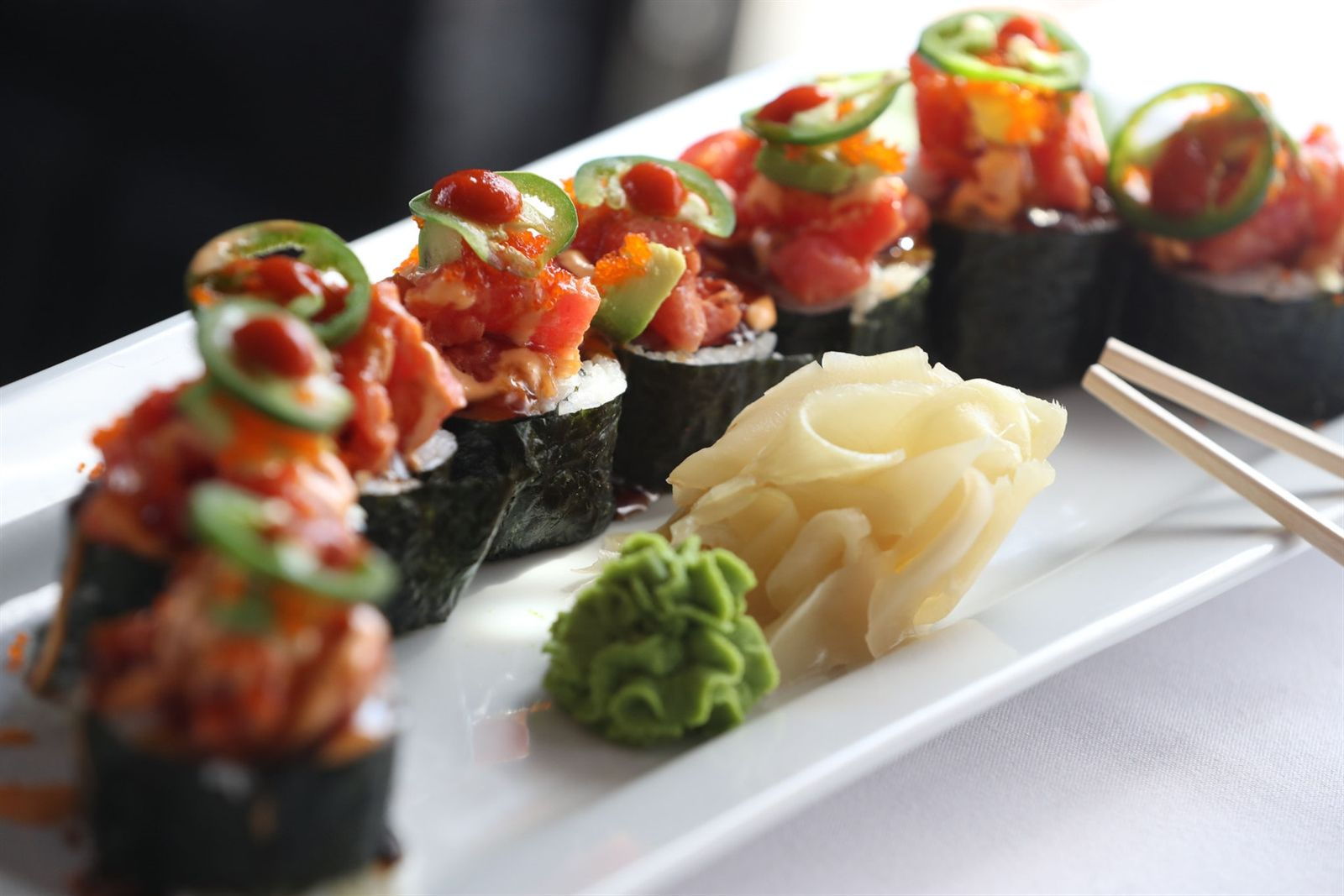 The Super Spicy Tuna Roll is made with cucumber, avocado, fish eggs, scallion, jalapeno, spicy sauce, teriyaki sauce and hot chili sauce.