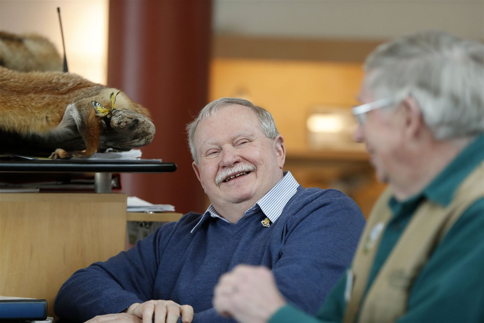 Tom Ridge Environmental Center Volunteers Michael Koncewicz, left, and Tom Golab share a laugh at the visitors desk.