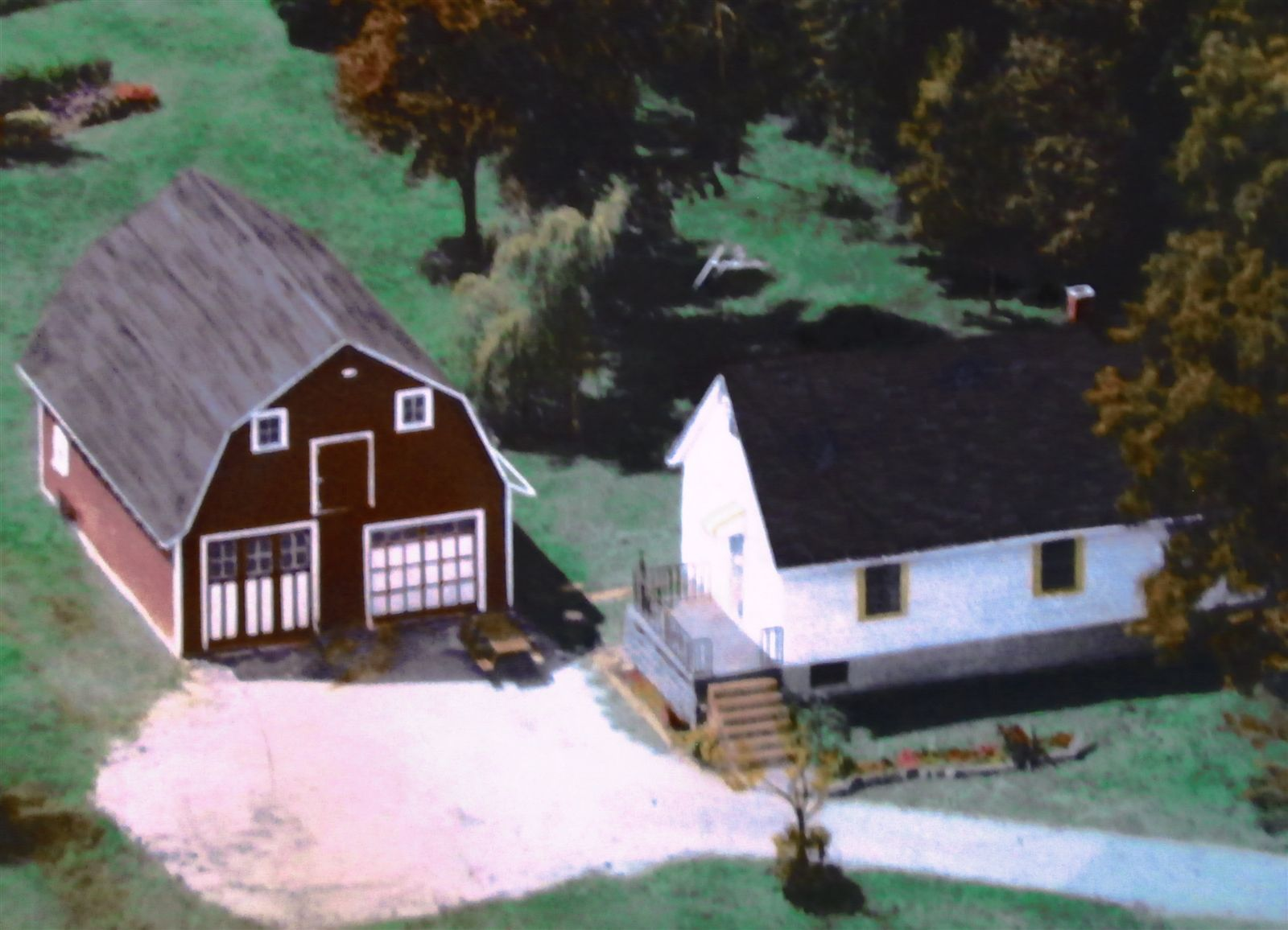 This is a photo of an oil painting of the property that was done before they lived in the house.