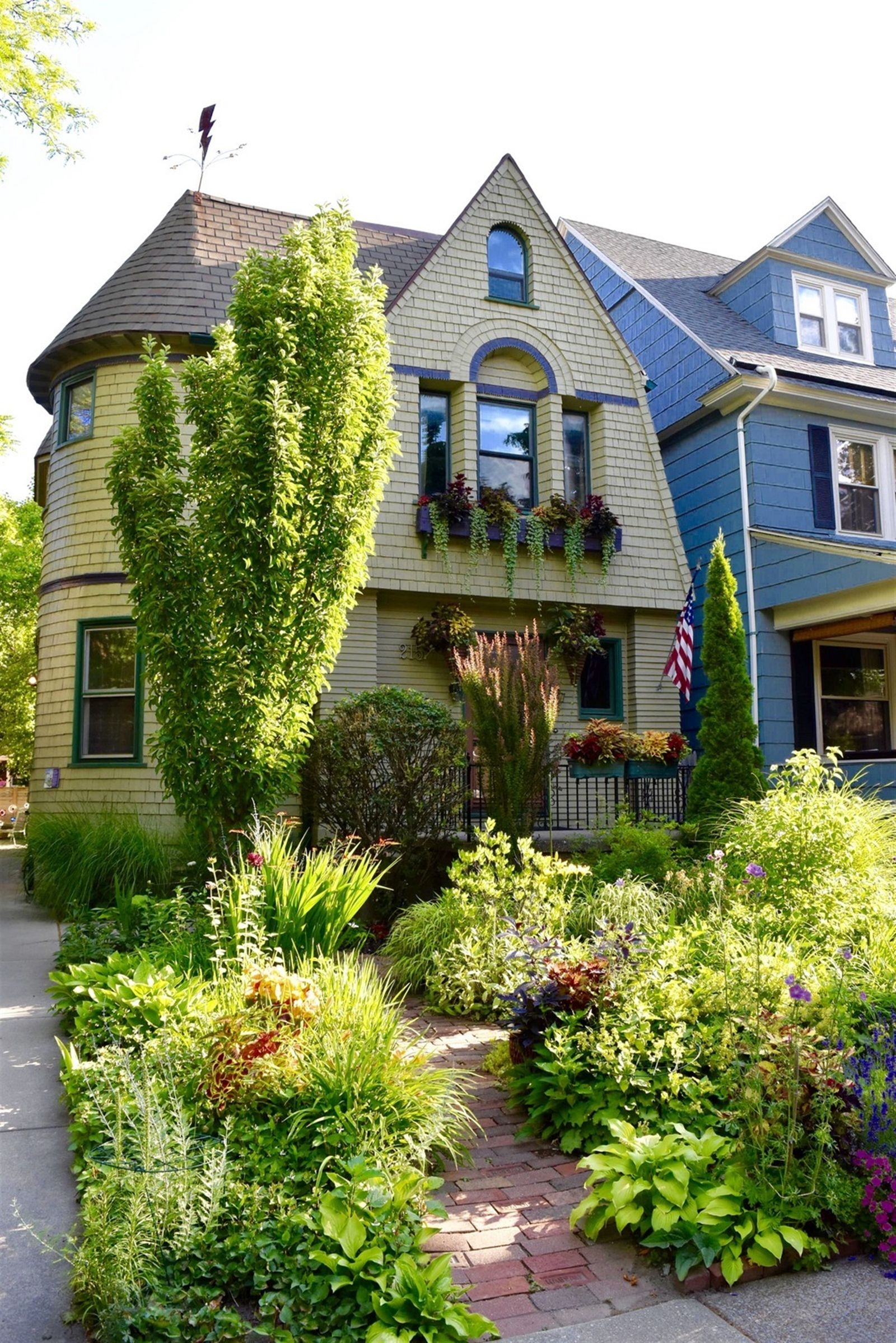 Jim and Leslie Charlier's home in Buffalo's Delaware District is an 1897 Dutch colonial, with a gambrel roof and rounded half tower.