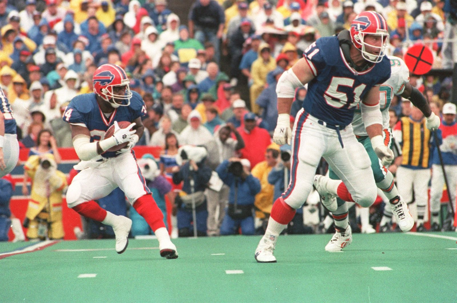 Buffalo Bills' running back Thurman Thomas and offensive lineman Jim Ritcher face the Miami Dolphins on Sept. 26, 1993.