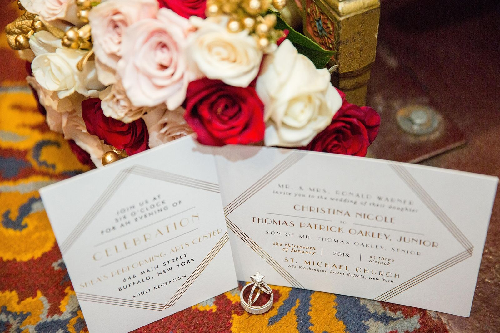 Invitations are from Minted. Floral arrangements were made by Maureen's Buffalo Wholesale Flower Market.