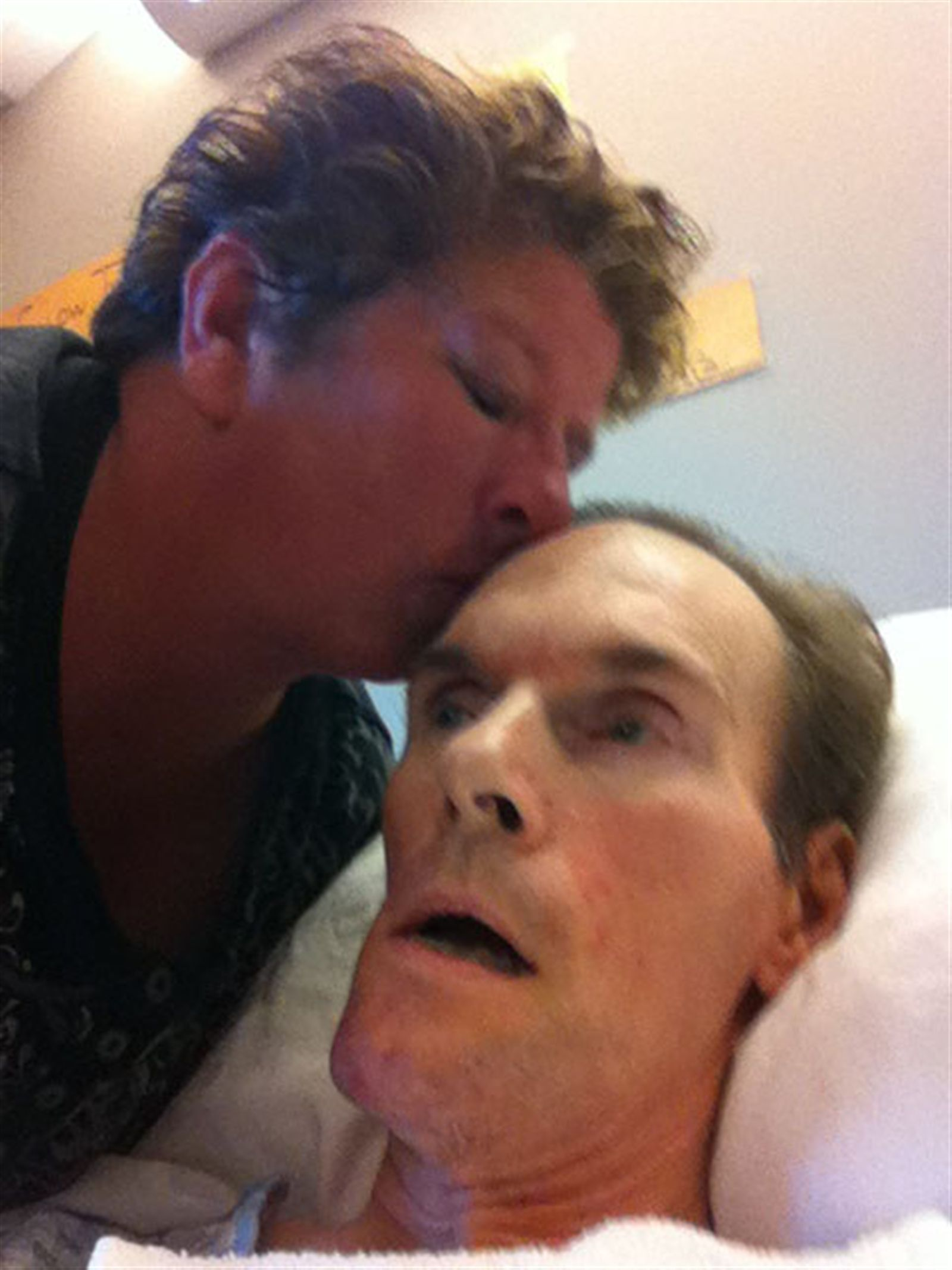 Patricia Myers kisses her bedridden husband, Larry, in his room at HighPointe on Michigan nursing home in a photo taken before Myers died. Myers, of Orchard Park, died Jan. 9, 2014, from Huntington's chorea, the disease that had robbed him of mobility and left him totally dependent on the nursing home staff.