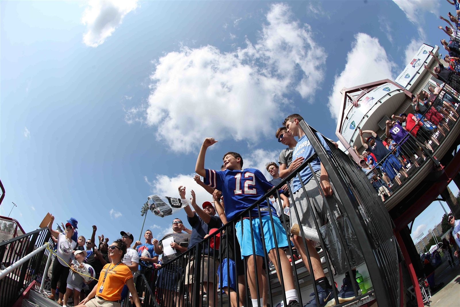 Fans enjoy watching the Bills practice from the Polisseni Track and Field Complex during the third day of training camp.