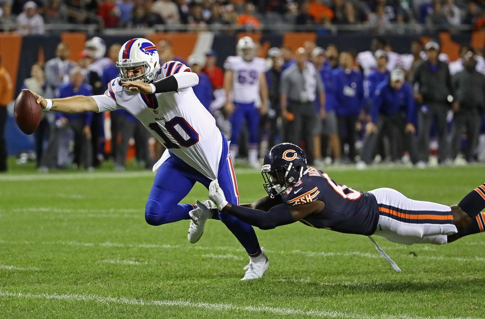 AJ McCarron of the Buffalo Bills breaks away from Ro'Derrick Hoskins of the Chicago Bears to score a touchdown.