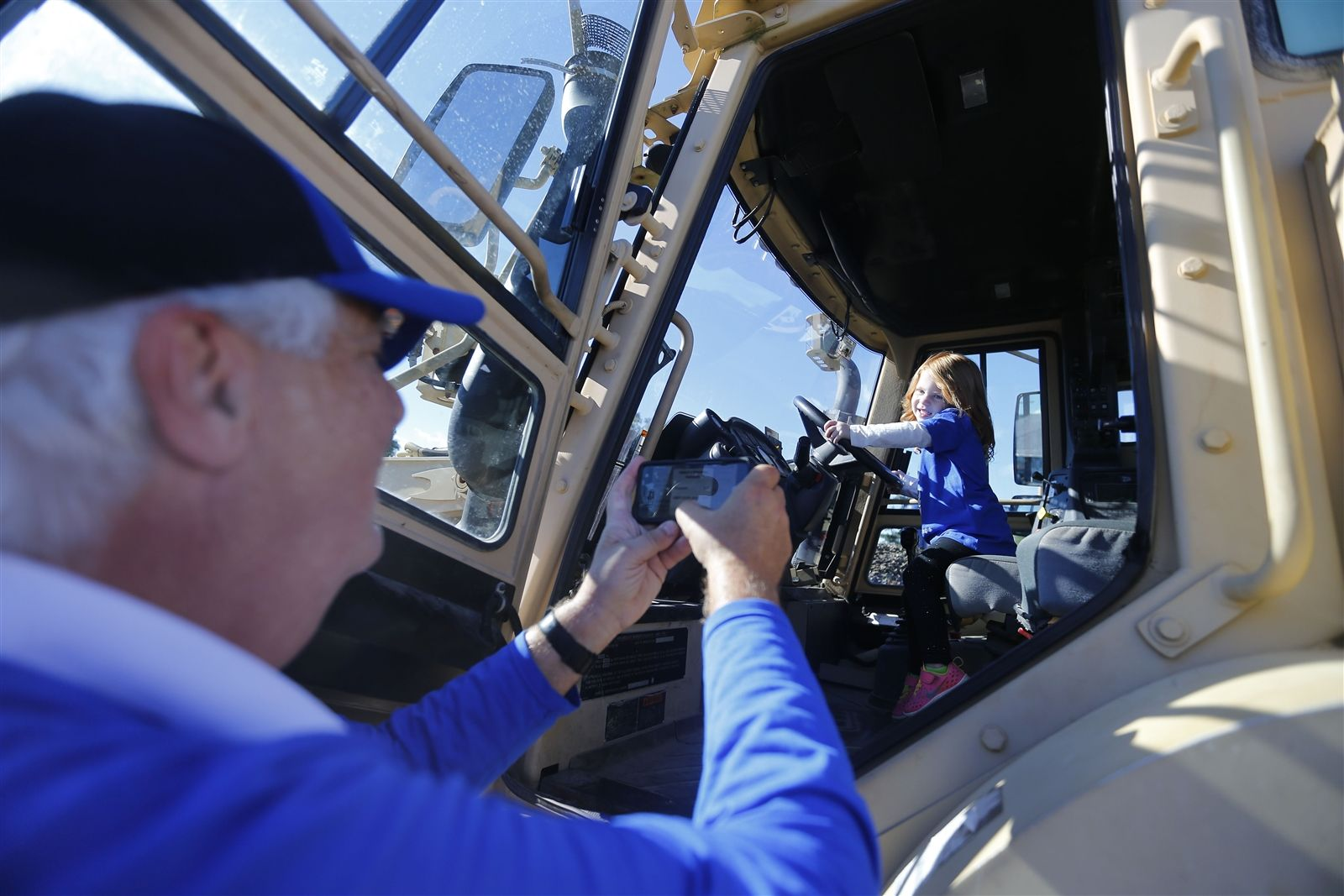 David Sorbo takes a picture of his niece Everly Rauch in a front end loader during tailgate festivities before the UB/Army game at UB Stadium in Amherst Saturday on September 29, 2018.